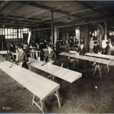 Women workers painting wing sections at the Alliance Aeroplane Company Ltd, Cambridge Grove.   Hammersmith and Fulham Archives