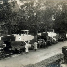 DH9 bombers on trucks outside the factory ready for delivery outside the Alliance Aeroplane Company Ltd, Cambridge Grove.   Hammersmith and Fulham Archives