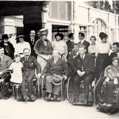 Visit of Queen Mary and Princess Mary to War Seal Mansions, with a group of ex-servicemen in wheelchairs, 5 Jun 1919.   Hammersmith and Fulham Archives