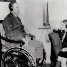 Mr Ripley, a disabled ex-servicemen in a wheelchair at the Sir Oswald Stoll Mansions, Fulham Road, 14 Aug 1925.   Hammersmith and Fulham Archives