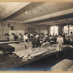 Women factory workers cutting cloth at Waring & Gillow's White City factory, 1914-1918. | City of Westminster Archive Centre